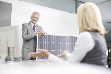 Two business colleagues discussing solar panel technology