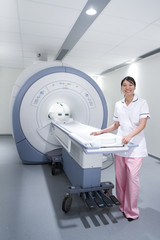Radiologist standing with MRI scanning machine