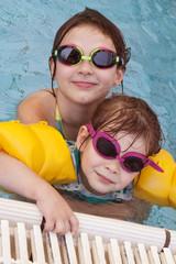 two girls smiling in swimming pool