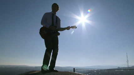 Man playing guitar on the roof