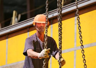Construction worker in orange hardhat