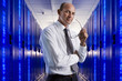 Portrait of businessman in network server room