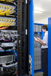 IT technician checking network server