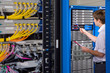 IT technician with folder checking network server