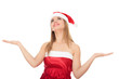 Pretty girl wearing red Christmas hat, holding a hand palm up