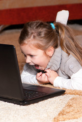 Portrait of a little girl with a laptop