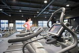 Woman running on treadmill in health club