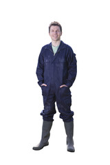 Farmer in coveralls with hands in pockets