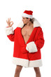 Sexy muscular man wearing a Santa Claus hat isolated on white