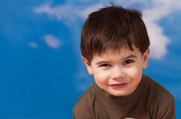 Smiling three year old boy
