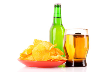 Potato chips in plate and beer isolated on white