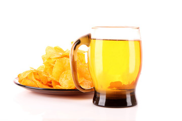 Potato chips in plate with cup of beer isolated on white