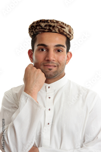 Happy ethnic man wearing traditional clothing