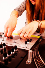 Hands of female DJ playing vinyl