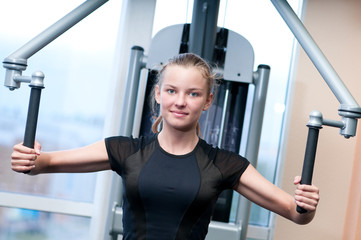 Young woman at the gym exercising