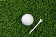 Golf ball and tee on grass