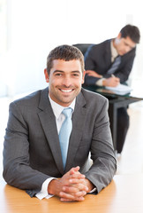 Cheerful businessman during a meeting with a colleague