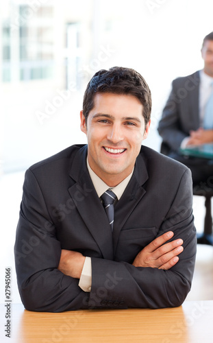 Delighted businessman in the foreground during a meeting with a