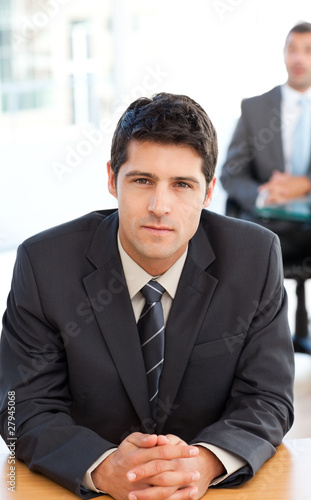Concentrated businessman during a meeting with a colleague