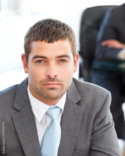 Serious businessman during a meeting with a colleague