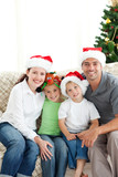 Adorable family at Christmas sitting in the living-room