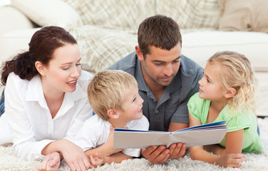 Cute family reading a children's book