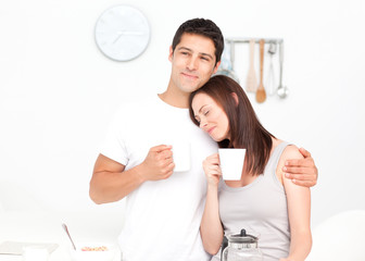 Lovely couple drinking coffee during breakfast