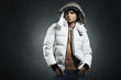 Fashion portrait of the young beautiful man in a white jacke