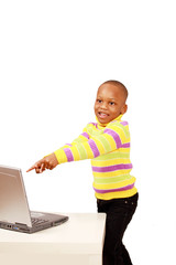 Happy excited kid pointing to computer
