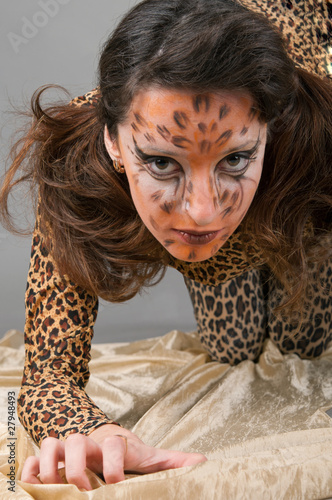 Portrait of girl with leopard's face-art
