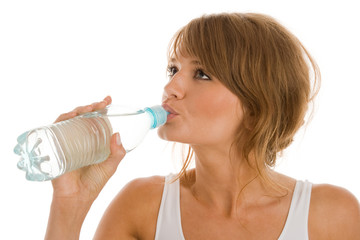 Woman drinking bottled mineral water