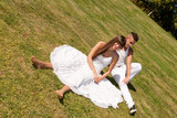 young couple happy sitting grass white, love relationship