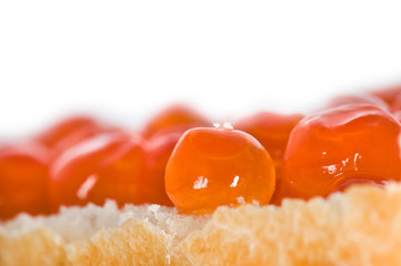 Close-up on a piece of bread with red caviar (fish roe)