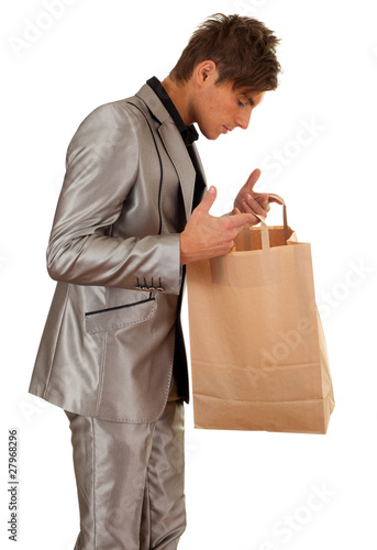 young man keeping recycled ecological paper bag