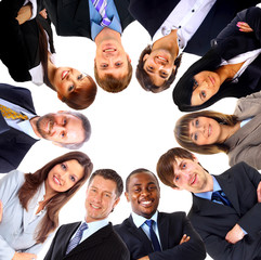 Group of business people standing in huddle