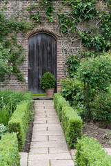 Secret garden. English garden path and door