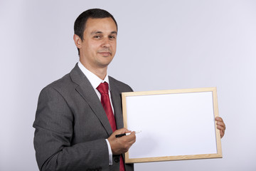 businessman holding a whiteboard