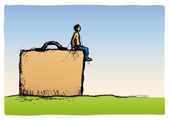 uomo sulla valigia