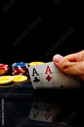 Male hand holding two aces