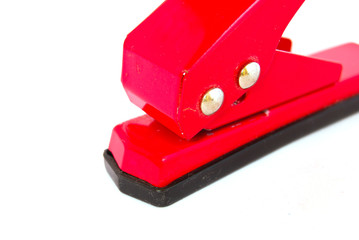 red office paper punch isolated