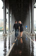 Bad weather in Paris. Couple on the Bir-Hakeim bridge at rain