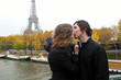 Couple in Paris, kissing at rain