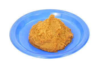 Re-fried beans on blue plastic plate