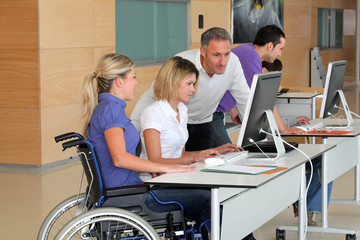 Woman in wheelchair working in the office