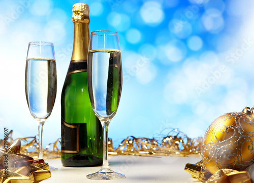 Glass of champagne against blue background . new year