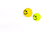 yellow and  green smile ball on white background