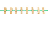 wooden clothespin and green rope on white background
