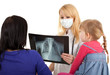 female doctor with x-ray chest examining little girl