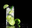 Mojito cocktail with fresh limes on a black background - 27992081