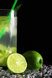 Mojito cocktail with fresh limes on a black background-